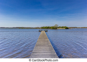 Wooden jetty at the Oldambtmeer lake in Oostwold