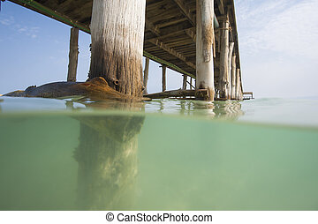 Wooden jetty on a tropical island beach
