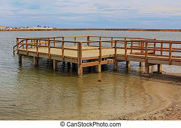 wooden jetty over a calm sea