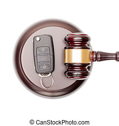 Wooden judge gavel and car keys over sound box - view from top