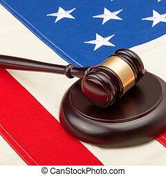 Wooden judge gavel and soundboard laying over USA flag - 1...