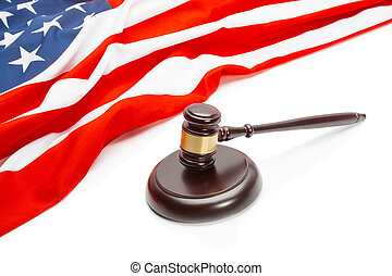 Wooden judge gavel near flag of Unites States of America -...