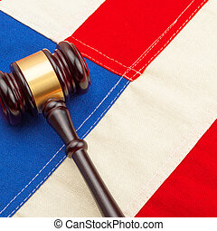 Wooden judge gavel over US flag - court judgment concept