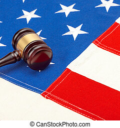 Wooden judge gavel over USA flag