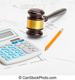 Wooden judge gavel with calculator and pencil over some documents - 1 to 1 ratio