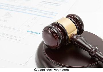 Wooden judge gavel with unpaid bill under it