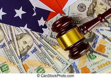Wooden judge hammer on american flag Justice law on us dollar currency american cash