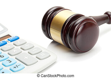 Wooden judge's gavel and calculator right next to it -...