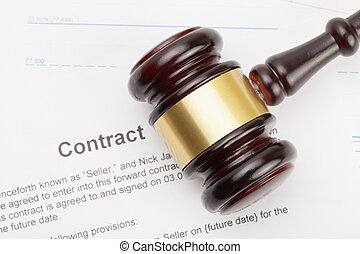 Wooden judge's gavel and contract