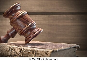 Wooden Judges Gavel And Old Law Books On Wooden Background