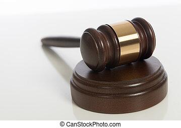 Wooden judge's gavel on white