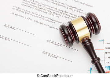 Wooden judge's gavel over unsigned contract