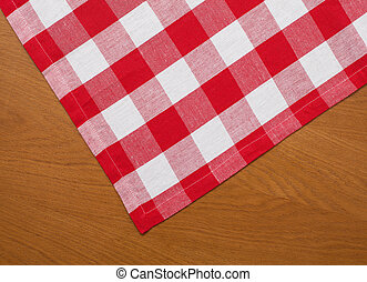 wooden kitchen table with red gingham tablecloth