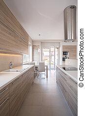 Wooden kitchen unit in bright luxury interior