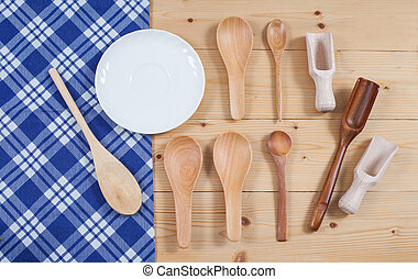 Wooden kitchen utensil on tablecloth background