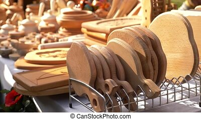 wooden kitchen utensils at the fair of folk crafts. 4k, slow...