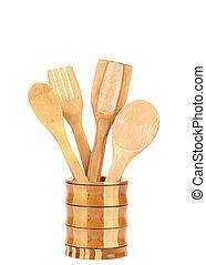 Wooden kitchen utensils in a jar.