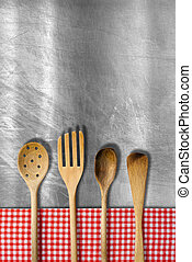 Wooden Kitchen Utensils on Metal Background