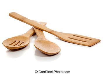 wooden kitchen utensils on white