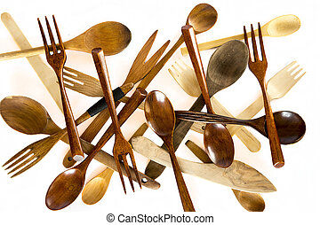 Wooden knifes, spoons and forks on white background