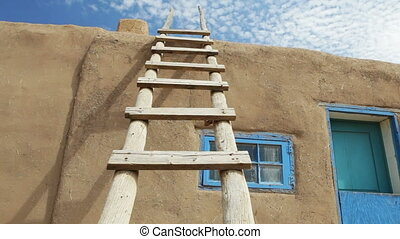 Wooden Ladder Against Adobe Building, Taos Pueblo, New...
