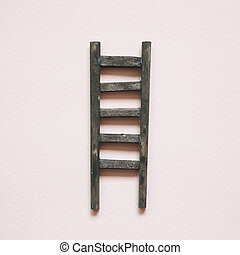 Wooden ladder on pink background