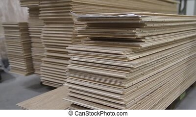 Piles of laminated floor panels in the workshop - Wooden...
