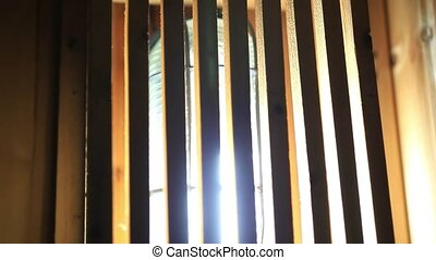 Wooden lamp in sauna room. HD. 1920x1080