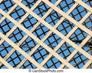 Wooden lattice open-air cage for greater birds in ancient...