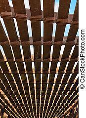 Wooden lattice. The roof of a street cafe made ??from wooden slats