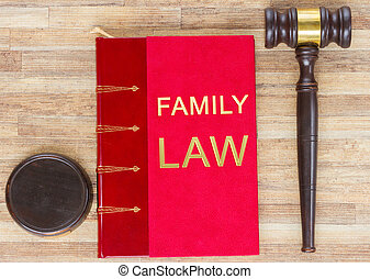 Wooden Law Gavel and red legal Family Law book on wooden...