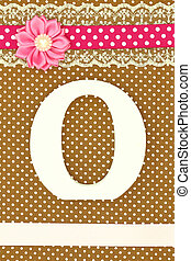 Wooden letter O on polka dots background