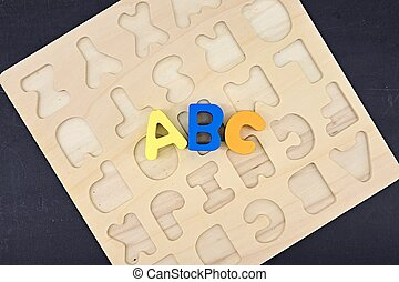 A studio photo of wooden letters