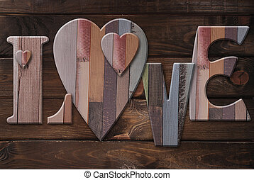 wooden letters love with hearts