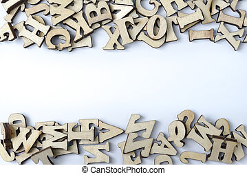 Wooden letters on a white background.