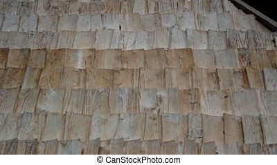 Wooden linings on Thatched Roof and A really close-up footage of the view of the old cabin cedar wooden shingle shake roof