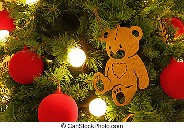 Wooden Little Bear Ornament with Red Christmas Ball on the Christmas tree