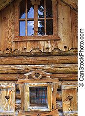 Wooden log cabin in the European Alps