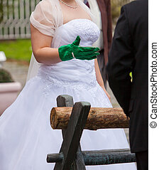 wooden log - German wedding tradition of sawing through a...