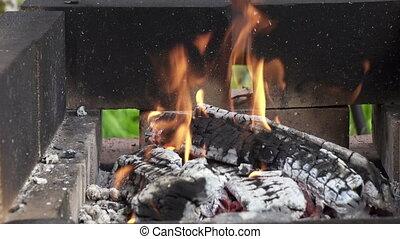 wooden logs burning in a brazier in street,Wooden shelves ...