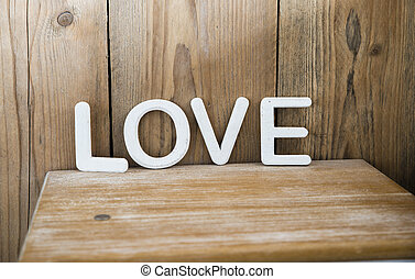 wooden love letters on bedside table