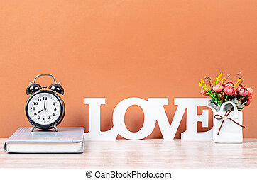 Wooden LOVE text on desk space.