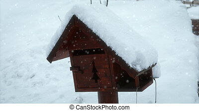 Wooden Mailbox Covered By Snow In The Mountain In Winter, Snow Falling, French Alps, France, Europe. Close Up View - DCi 4K Resolution