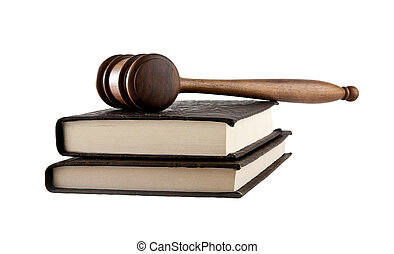 wooden mallet and a book on a white background