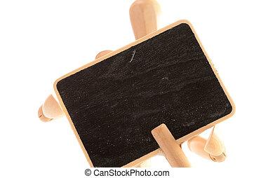 Wooden man with a blackboard