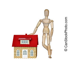 Wooden mannequin and a house