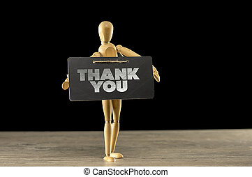 Wooden mannequin holding a thank you sign