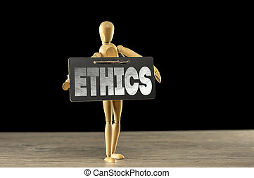 Wooden mannequin holding an ethics sign