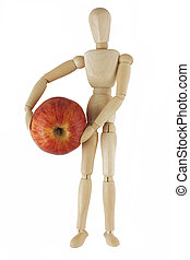 Wooden mannequin holds red apple