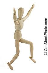 Wooden mannequin jumps